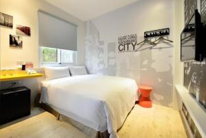 A bed or beds in a room at NL Concept Hotel