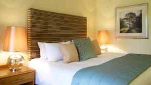 A bed or beds in a room at Marwell Hotel - A Bespoke Hotel