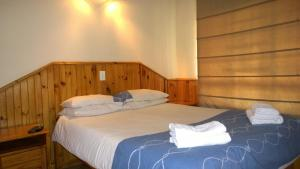 A bed or beds in a room at Panorama Chalets & Rest Camp