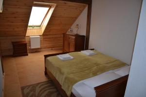 A bed or beds in a room at Chalet Hotel