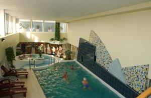 The swimming pool at or near Hunguest Hotel Répce