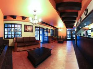 The lobby or reception area at Hotel Hacienda Del Rio