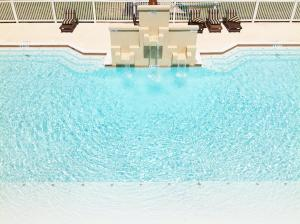 The swimming pool at or near La Isla South Padre Residences