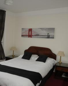 A bed or beds in a room at Wimblehurst Hotel