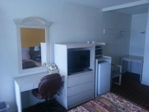 A television and/or entertainment center at XIT Ranch Motel