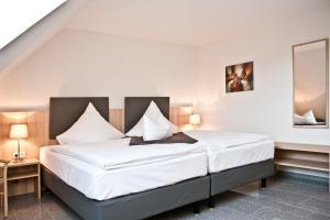 Ein Bett oder Betten in einem Zimmer der Unterkunft Ostsee Ferienhäuser