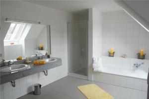 Ein Badezimmer in der Unterkunft Ostsee Ferienhäuser