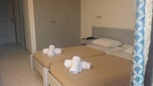Ένα ή περισσότερα κρεβάτια σε δωμάτιο στο Summer Days