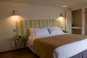 Cama o camas de una habitación en Hotel Boutique La Perouse