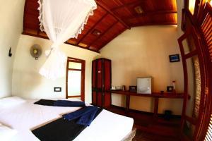 Ein Bett oder Betten in einem Zimmer der Unterkunft Ella Okreech Cottages