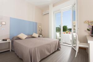 Letto o letti in una camera di New Hotel Chiari