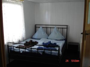 Кровать или кровати в номере Ferienhaus Süplingen