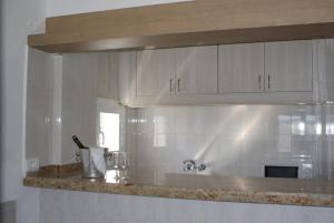 A kitchen or kitchenette at Apartamentos El Moro