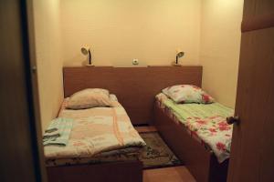Кровать или кровати в номере Лион Отель