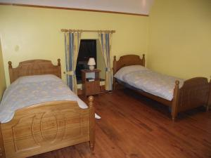 A bed or beds in a room at Pine View Self Catering Holiday Home