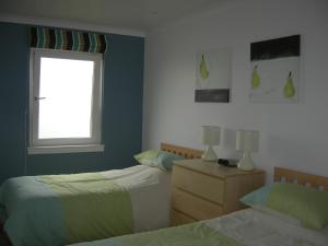 A bed or beds in a room at Beach View Apartment