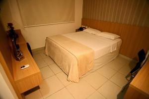 A bed or beds in a room at Hotel Talissa 2