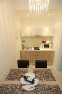 A kitchen or kitchenette at Zadar Street Apartments and Room