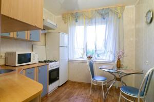 Кухня или мини-кухня в Comfort Apartments