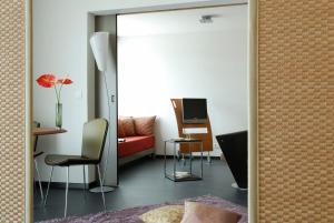Телевизор и/или развлекательный центр в Aparthotel Adagio Bordeaux Centre Gambetta
