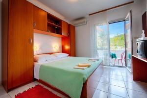 Posteľ alebo postele v izbe v ubytovaní Apartments Malo Lago