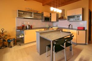 A kitchen or kitchenette at Apartmány Doky Holiday