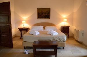 A bed or beds in a room at Casale del Murgese Country Resort