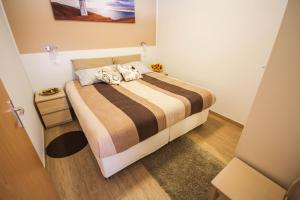 A bed or beds in a room at Apartments Lavanda & Cappuccino