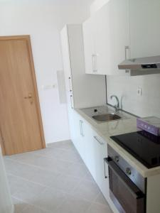 A kitchen or kitchenette at Apartments Bedene