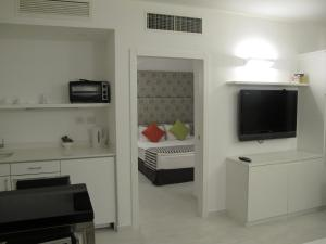 A television and/or entertainment center at Best Western Regency Suites