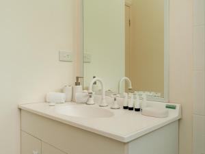 A bathroom at Sunset Waters 6 - Hamilton Island