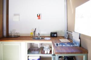A kitchen or kitchenette at Durrell Wildlife Camp