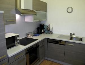 A kitchen or kitchenette at Old Vienna Apartments