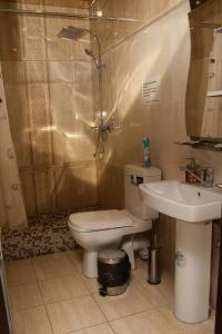 Ванная комната в 555 Отель