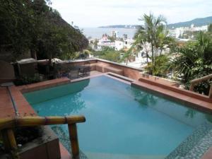 Vista de la piscina de Condominios Vista Banderas o alrededores