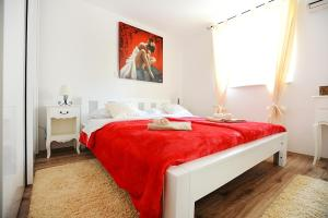 A bed or beds in a room at Apartment Primera
