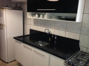 A kitchen or kitchenette at Apartamento Pantanal