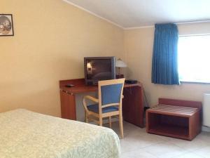 Ein Sitzbereich in der Unterkunft Cerruti Hotel