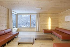 A seating area at Scuol Youth Hostel