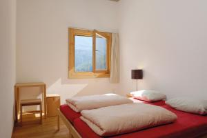 A bed or beds in a room at Scuol Youth Hostel