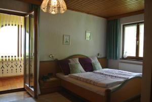 A bed or beds in a room at Landhaus Neubauer - Zimmer