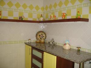 A kitchen or kitchenette at Casa da Bivó Mafalda