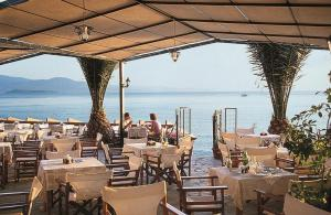 A restaurant or other place to eat at Triena Rooms