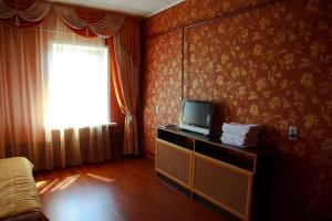 A television and/or entertainment center at Lubas Apartment Monastery View