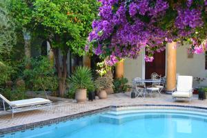 The swimming pool at or near Riad El Arsat & Spa