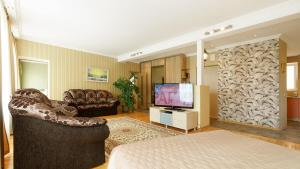 A television and/or entertainment center at Daugava Lux Apartments