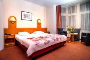 Un ou plusieurs lits dans un hébergement de l'établissement Owl Hotel