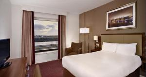 A bed or beds in a room at DoubleTree by Hilton London Chelsea