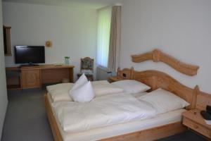 Ein Bett oder Betten in einem Zimmer der Unterkunft Hamborner Mühle