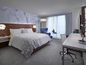 A bed or beds in a room at Renaissance Edmonton Airport Hotel